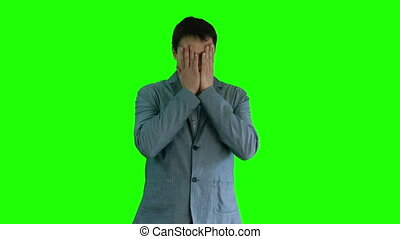 A man in a suit tired and nervous green screen