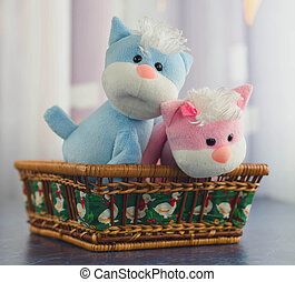 soft toys cats in a basket