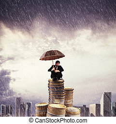 Lonely with savings - Businessman on top of a coins stack