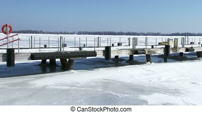Dock on frozen lake Ontario in front of Torontos waterfront...