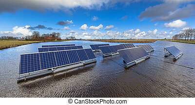 Floating solar farm - Groups of Floating solar panels on...