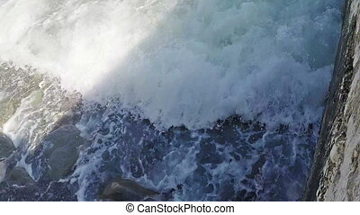 Background from sea waves which beat the shore