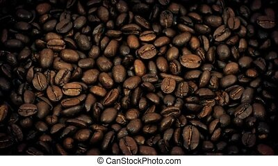 Coffee Beans Rotating Slowly - Overhead shot of rich coffee...
