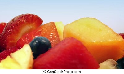 Tasty Mixed Fruit Rotating Closeup - Bowl of fruit salad...