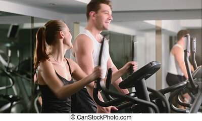 a girl and a guy do in the gym in the sports hall