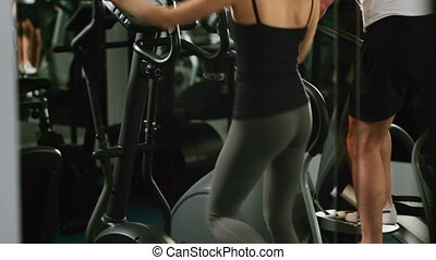 girl and guy are in the gym - a girl and a guy are in the...
