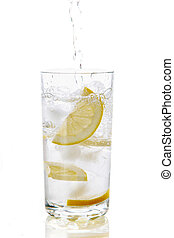 Pouring - Image of mineral water in glass on a white...