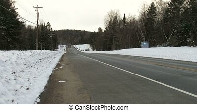Truck driving on highway 60 in Algonquin Provincial Park,...