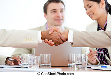 Business people closing a deal  in the office