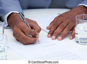 Close-up of ambitious business man signing a contract in a...