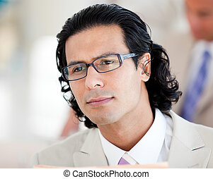 Handsome businessman wearing glasses in the office