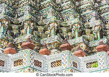 Wat Arun - Detail of the temple of Wat Arun with statues of...