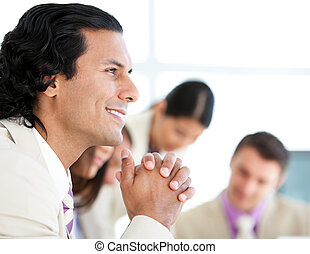 Self-assured businessman in a meeting with his team