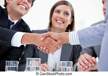 Handshaking during a presentation with a pretty business...