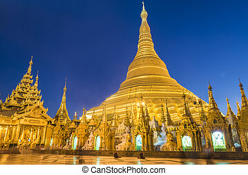 Shwedagon Paya is the most sacred golden buddhist pagoda in...