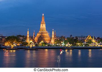 Wat Arun - Large illuminated temple Wat Arun after sunset...