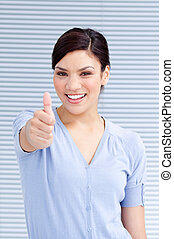 Cheerful businesswoman with a thumb up