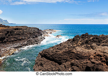 queen's bath at kauai - view at rocky seashore at queen's...