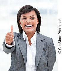 Portrait of a fortunate business woman with a thumb up