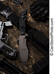 Knife and military set - Military knife with rifle on black...