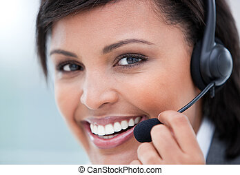 Woman working in a call center and smiling