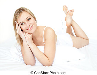 Sexy woman on her bed white background