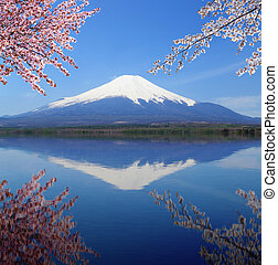 Mt.Fuji with water reflection at Lake Yamanaka, Japan -...