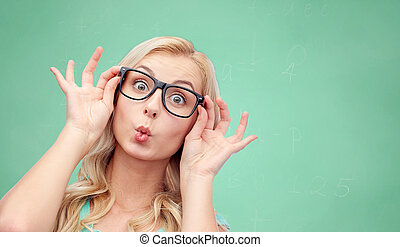 happy young woman in glasses making fish face - vision,...