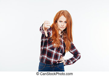 Woman showing thumb down - Young redhead woman showing thumb...