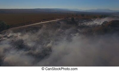 Fire On Huge Garbage Dump - AERIAL VIEW. Huge dump is in...