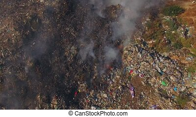 Huge Burning Waste Deposit Covered With Smoke - AERIAL VIEW...