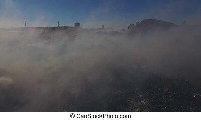 Big Heap Of Trash Burning Polluting Atmosphere