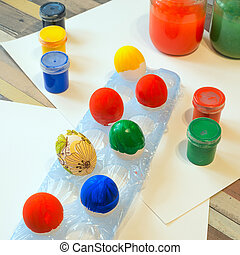 Painted Easter eggs on wooden table