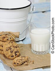 Stack of cookies with glass of milk - One bitten and stack...