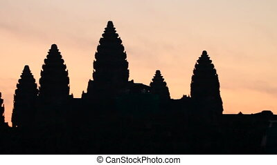 Sunrise in Angkor Wat, a temple complex in Cambodia and the...