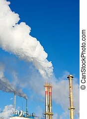 Contamination - Smokestacks in a paper mill, Zaragoza...