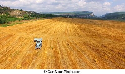 Tractor With Trailer Moving On Harvested Field - AERIAL VIEW...