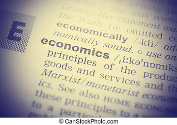 Close-up of word in English dictionary. Economics,...
