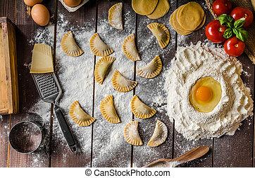 Preparing homemade tortellini - Preparing homemade pesto...
