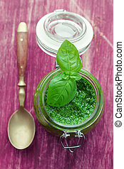 Pesto in glass jar - Pesto in a glass jar with a spoon on...