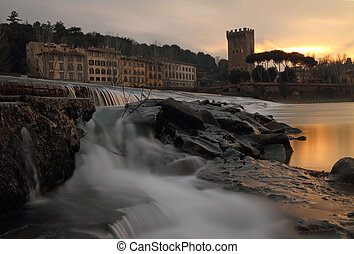 Wonderful sunset at waterfallas on river Arno in Florence -...