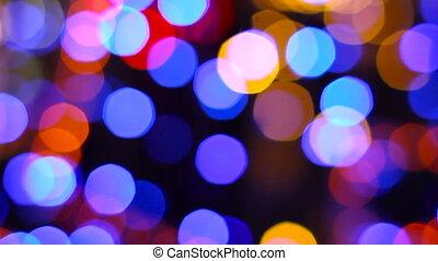Defocused night street lights, blurred colorful bokeh...