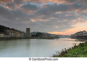 sunset at riverbank in monumental city of Florence -...