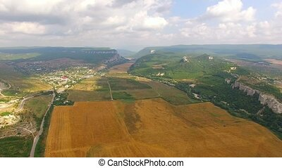 Rural Landscape With Harvest Field At Hilly Valley - AERIAL...