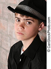 Teenage Boy - Teenage boy wearing a black hat in casual wear...
