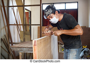 carpenter man take a planer tool wi