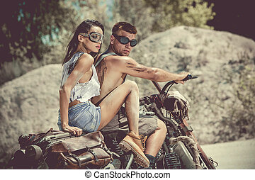 Sexy couple of bikers on the old motorcycle.