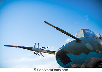 war plane - military aircraft against a background of blue...