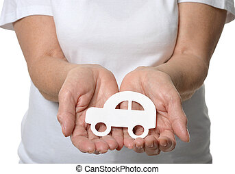 Close up of womans hands holding model car isolated on white...