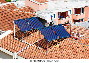 Solar panels on the house red tiled roof